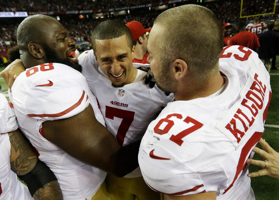 San Francisco 49ers\' Colin Kaepernick (7) celebrates with Leonard Davis and Daniel Kilgore (67) after the NFL football NFC Championship game against the Atlanta Falcons Sunday, Jan. 20, 2013, in Atlanta. The 49ers won 28-24 to advance to Superbowl XLVII. (AP Photo/Dave Martin)