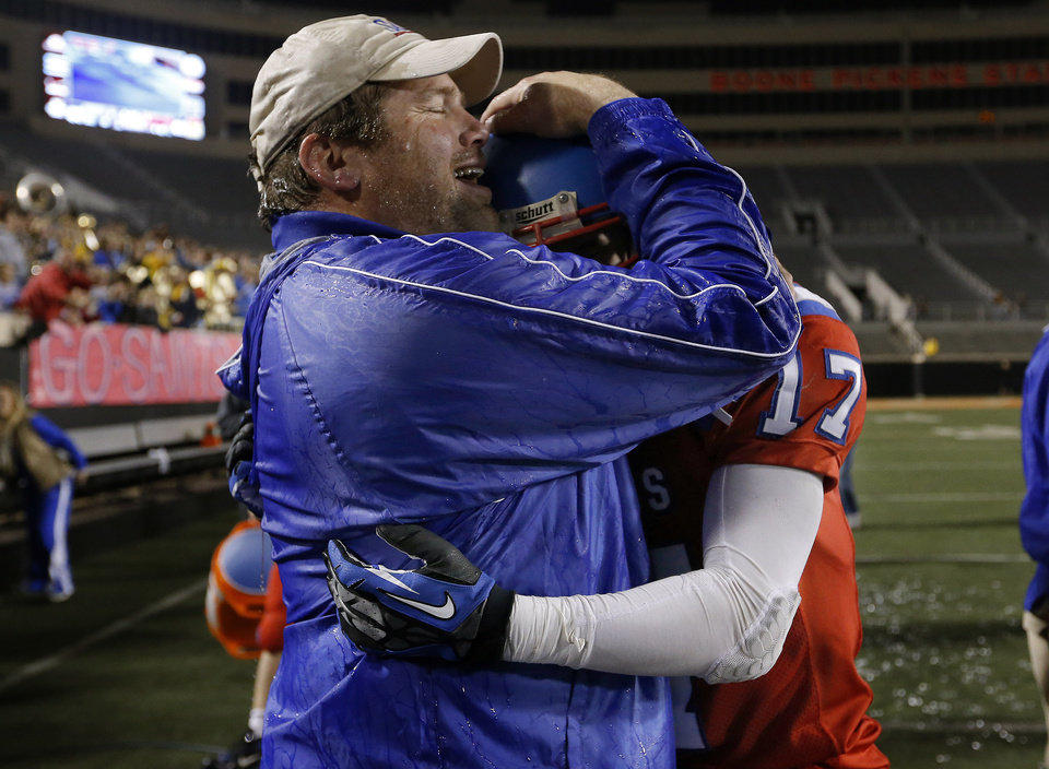OCS head coach Derek Turner celebrates with Blake Summers following the Class 2A high school football championships between Davis and Oklahoma Christian School at Boone Pickens Stadium in Stillwater, Okla.,  Saturday,Dec. 8, 2012. Photo by Sarah Phipps, The Oklahoman