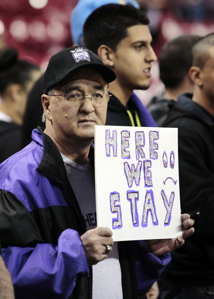 Sacramento Kings season ticket holder John Willett holds a sign before an NBA basketball game against the Dallas Mavericks in Sacramento, Calif., Thursday, Jan. 10, 2013. Word of the possible sale of the team to investor Chris Hansen who would move the franchise to Seattle has Kings fan showing their support with hopes they will remain in Sacramento. (AP Photo/Rich Pedroncelli)
