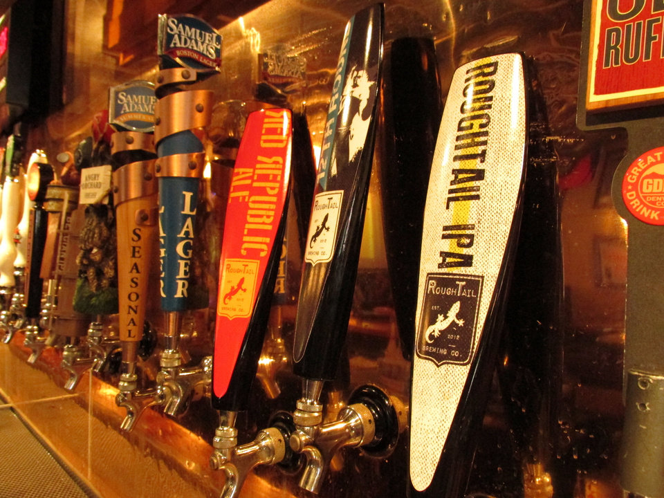 Part of the lineup of beer taps at TapWerks Ale House in Bricktown. TapWerks will be host of the third annual Oklahoma Craft Beer Festival. PHOTO BY NICK TROUGAKOS, THE OKLAHOMAN <strong></strong>