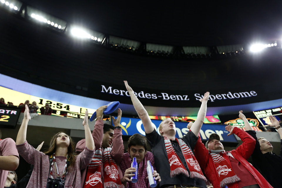 Photo - Oklahoma fans cheer during the Allstate Sugar Bowl between University of Oklahoma Sooners (OU) and Auburn University Tigers at the Mercedes-Benz Superdome in New Orleans, Monday, Jan. 2, 2017.  Photo by Sarah Phipps, The Oklahoman