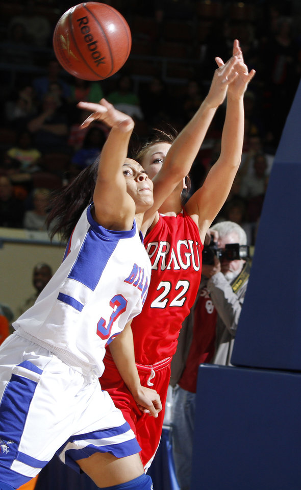 Millwood's Quira Demery, left, goes for the ball beside Prague's Brooke Watkins during the Class 3A girls high school state basketball championship game at State Fair Arena in Oklahoma City, Saturday, March 10, 2012. Photo by Bryan Terry, The Oklahoman