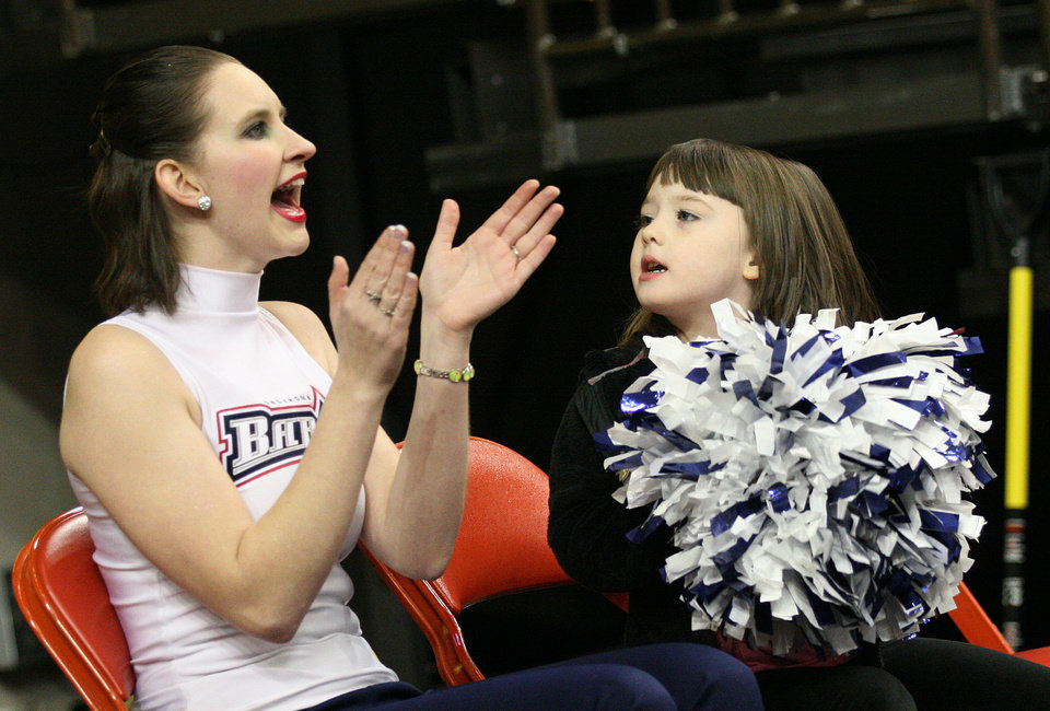 Photo - AHL HOCKEY / CHILD / CHILDREN / KIDS / FANS: OKC Barons Ice Girl, Mirielle Chambers, and Raelynn Dodd, 5 of Newcastle, cheer during a game between the Oklahoma City Barons and the Rochester Americans at the Cox Convention Center in Oklahoma City, Tuesday, Dec. 27, 2011.  Photo by Garett Fisbeck, The Oklahoman  ORG XMIT: KOD