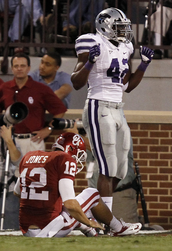 Kansas State's Meshak Williams (42) reacts after the Wildcats scored a touchdown on a fumble by Oklahoma's Landry Jones (12) during the college football game between the University of Oklahoma Sooners (OU) and the Kansas State University Wildcats (KSU) at the Gaylord Family-Memorial Stadium on Saturday, Sept. 22, 2012, in Norman, Okla. Photo by Chris Landsberger, The Oklahoman