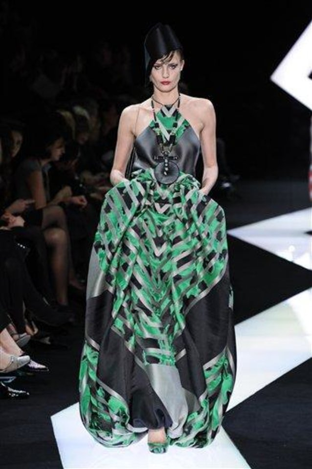 Photo - A model wears a creation by fashion designer Giorgio Armani as part of his Spring/Summer 2013 Haute Couture fashion collection, in Paris, Tuesday, Jan. 22, 2013. (AP Photo/Zacharie Scheurer)