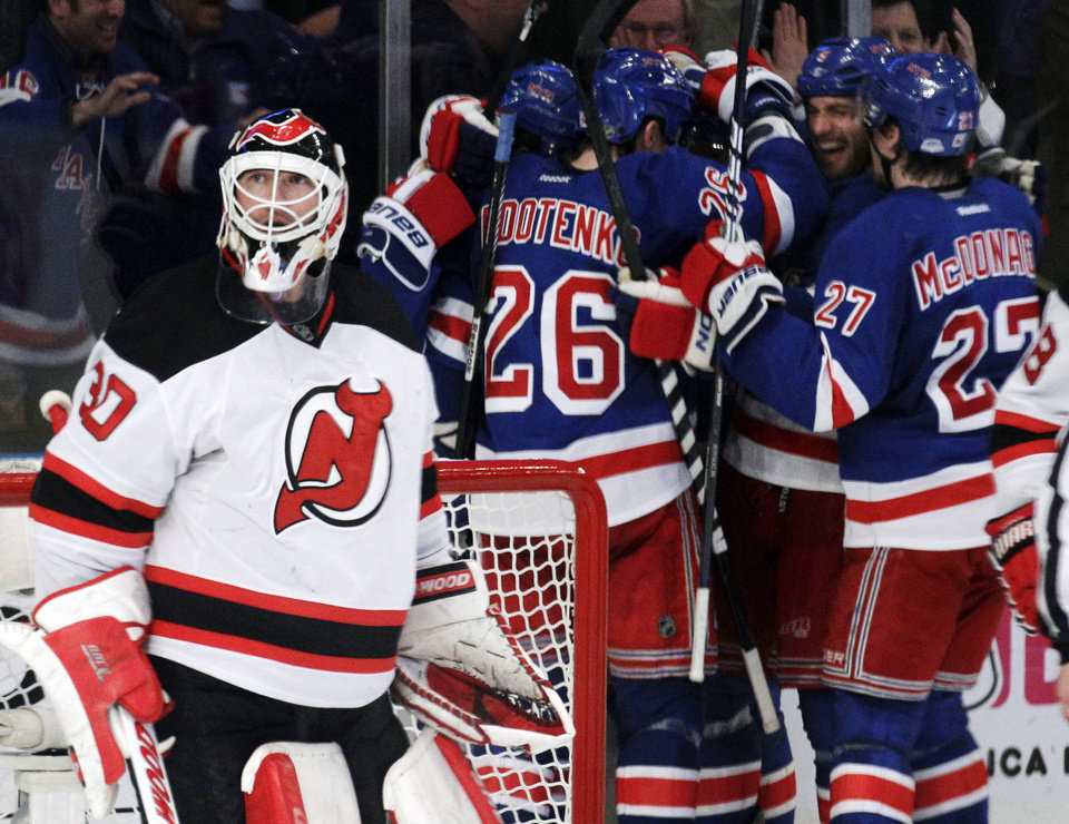 Photo -   New Jersey Devils goalie Martin Brodeur looks up as New York Rangers players celebrate a goal by Marian Gaborik, of Slovakia, during the third period of Game 5 of an NHL hockey Stanley Cup Eastern Conference final playoff series, Wednesday, May 23, 2012, in New York. (AP Photo/Frank Franklin II)