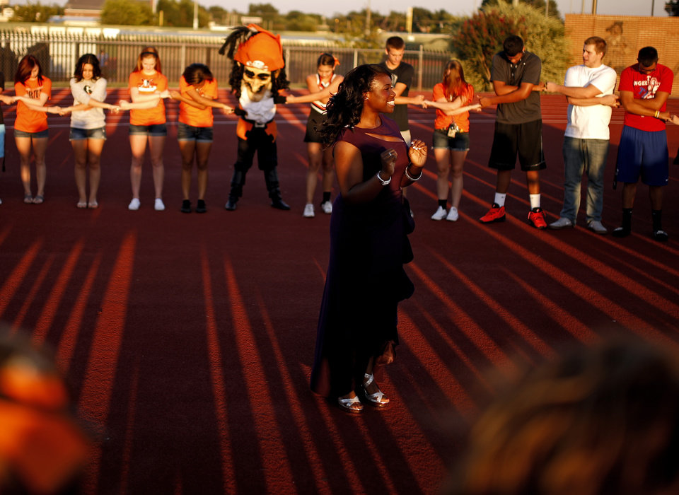 Putnam City students gather to say a prayer before Putnam City\'s football game against Sapulpa at Putnam City in Oklahoma City, Thursday, Sept. 26, 2013. Photo by Bryan Terry, The Oklahoman