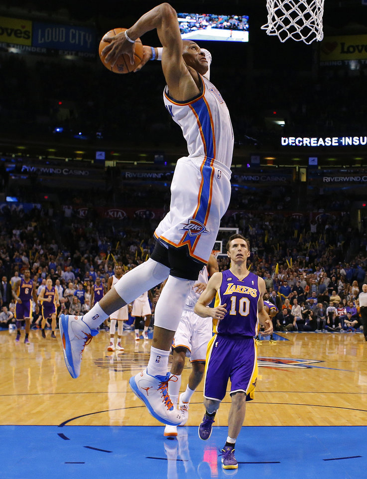 Oklahoma City\'s Russell Westbrook (0) goes up for a dunk as Los Angeles\' Steve Nash (10) watches during an NBA basketball game between the Oklahoma City Thunder and the Los Angeles Lakers at Chesapeake Energy Arena in Oklahoma City, Tuesday, March. 5, 2013. Photo by Bryan Terry, The Oklahoman