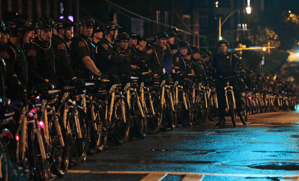 Photo - Police block a street before Occupy demonstrators move during an unscheduled protest march, Tuesday, Sept. 4, 2012, in Charlotte, N.C. The Democratic National Convention begins today. (AP Photo/Gerry Broome) ORG XMIT: XDNC167