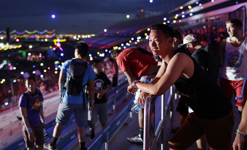 Photo - Festival goers look over the the sights of the Electric Daisy Carnival as they enter the Las Vegas Motor Speedway for the event Saturday, June 21, 2014, in Las Vegas. Doors open at 7 p.m. each night and the music would last until dawn. (AP Photo/John Locher)
