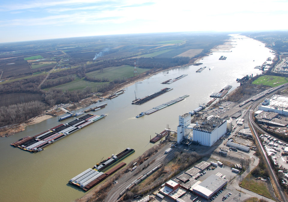 Photo - This Dec. 5, 2012 photo provided by The United States Coast Guard shows barges passing in tight quarters due to low water levels as they navigate the Mississippi River near St. Louis. In a letter obtained by The Associated Press Thursday, Dec. 6, 2012, Army Assistant Secretary Jo-Ellen Darcy, a top Army Corps official, turned back requests by federal lawmakers and the barge industry to release more of the Missouri River it is withholding, believing the drought-starved Mississippi River the Missouri feeds still will remain open to shipping despite mounting concerns. (AP Photo/United States Coast Guard, Colby Buchanan)