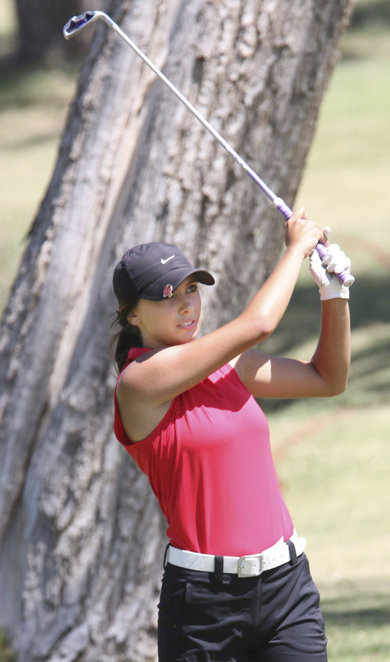 Photo - Cleveland's Maddie DiBernardo, junior watches a fairway shot at Lake Hefner golf course in Oklahoma City,  Wednesday May 07, 2014. Photo By Steve Gooch, The Oklahoman