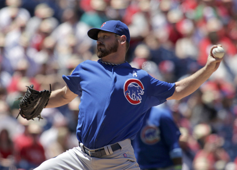 Photo - Chicago Cubs starting pitcher Travis Wood throws against the Philadelphia Phillies in the first inning of a   baseball game on Sunday, June 15, 2014, in Philadelphia. (AP Photo/H. Rumph Jr)