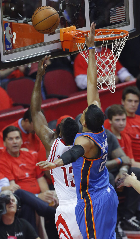 Photo - Oklahoma City's Andre Roberson (21) blocks the shot of Houston's James Harden (13) during Game 5 in the first round of the NBA playoffs between the Oklahoma City Thunder and the Houston Rockets at the Toyota Center in Houston, Texas,  Tuesday, April 25, 2017.  Photo by Sarah Phipps, The Oklahoman