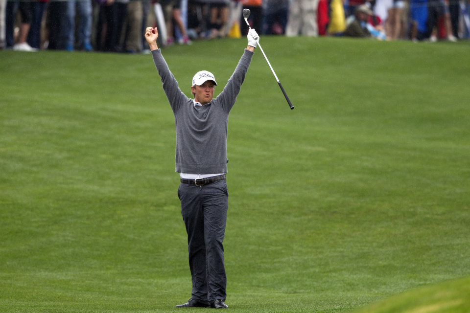 Photo - Matt Jones celebrates after chipping in for birdie on a playoff hole against Matt Kuchar to win the Houston Open golf tournament on Sunday, April 6, 2014, in Humble, Texas. (AP Photo/Patric Schneider)