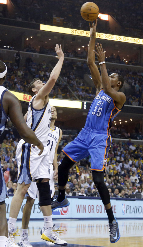 Photo - Oklahoma City's Kevin Durant (35) shoots  over Memphis' Marc Gasol (33) during Game 6  in the first round of the NBA playoffs between the Oklahoma City Thunder and the Memphis Grizzlies at FedExForum in Memphis, Tenn., Thursday, May 1, 2014. Photo by Bryan Terry, The Oklahoman