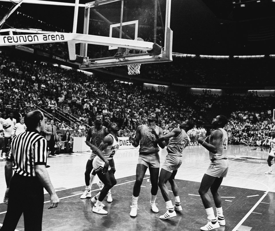 MARCH 21, 1985.    OU COLLEGE BASKETBALL: Players watch as the bounces around the goal shot by University of Oklahoma's Wayman Tisdale, for the  game-winning score against Louisiana Tech in Dallas during the NCAA tournament. (PHOTO BY DOUG HOKE/THE OKLAHOMAN)
