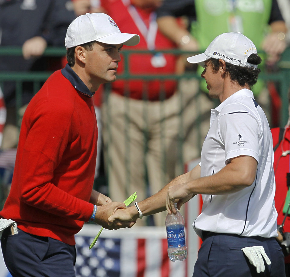 Europe's Rory McIlroy, right, shakes hands with USA's Keegan Bradley before a singles match at the Ryder Cup PGA golf tournament Sunday, Sept. 30, 2012, at the Medinah Country Club in Medinah, Ill. (AP Photo/Charles Rex Arbogast)  ORG XMIT: PGA105