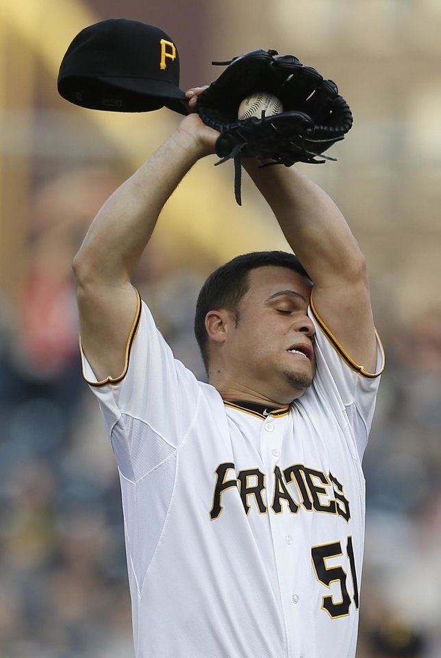 Photo - Pittsburgh Pirates starting pitcher Wandy Rodriguez (51) wipes his head as he throws against the Baltimore Orioles in the first inning of the baseball game on Wednesday, May 21, 2014, in Pittsburgh . (AP Photo/Keith Srakocic)