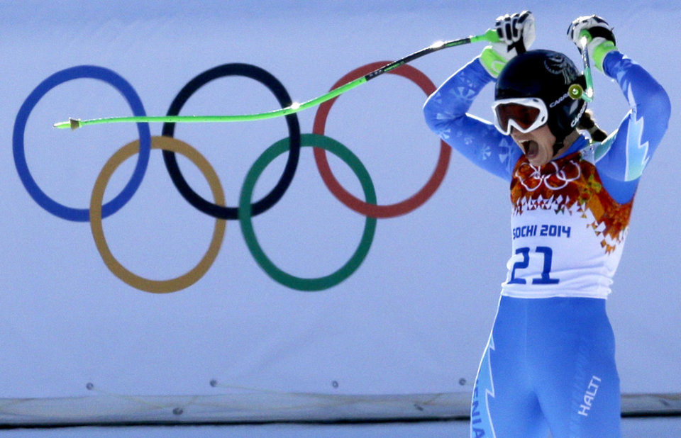 Photo - Slovenia's Tina Maze celebrates after finishing the women's downhill, to tie for first place with Switzerland's Dominique Gisin at the Sochi 2014 Winter Olympics, Wednesday, Feb. 12, 2014, in Krasnaya Polyana, Russia. (AP Photo/Kirsty Wigglesworth)