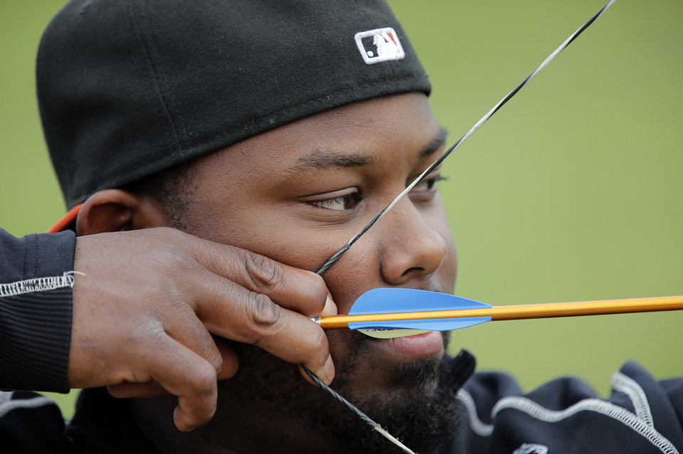 Aaron McMihelk, of California, prepares to shoot in the archery clinic during the opening day of activities for the Endeavor Games at the University of Central Oklahoma on Thursday, June 6, 2013 in Edmond, Okla. Photo by Chris Landsberger, The Oklahoman