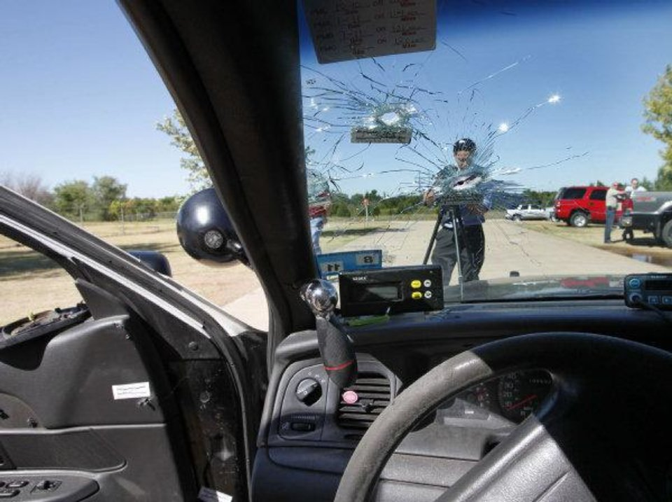 This is a view from the inside of the car of the Oklahoma City police officer who was ambushed and shot multiple times after a Sunday night traffic stop. By Paul Hellstern, The Oklahoman ORG XMIT: KOD <strong>PAUL HELLSTERN</strong>
