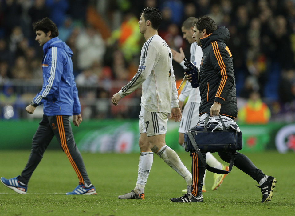 Photo - Real's Cristiano Ronaldo leaves the game during a Champions League quarterfinal first leg soccer match between Real Madrid and Borussia Dortmund at the Santiago Bernabeu   stadium in Madrid, Spain, Wednesday April 2, 2014. (AP Photo/Paul White)