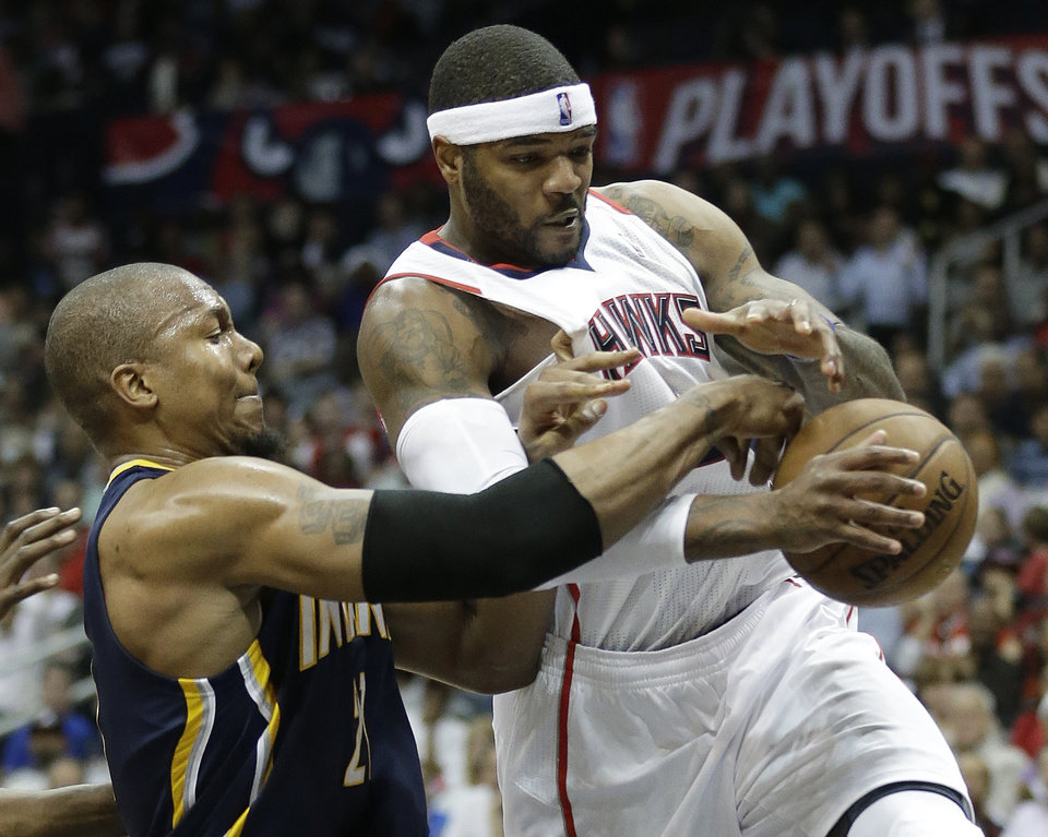 Photo - Indiana Pacers power forward David West (21) vies for a loose ball against Atlanta Hawks small forward Josh Smith (5) during the second half in Game 4 of their first-round NBA basketball playoff series,basketball game Monday, April 29, 2013 in Atlanta.  (AP Photo/John Bazemore)