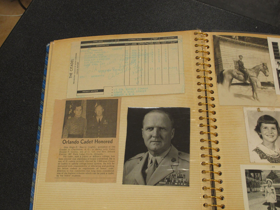 Photo - In this May 8, 2014 photo, a scrapbook kept by author Pat Conroy's father Donald is displayed at the University of South Carolina's library in Columbia, SC. Conroy is giving the university all of his papers including handwritten manuscripts, journals and even his divorce papers. (AP Photo/Jeffrey Collins)