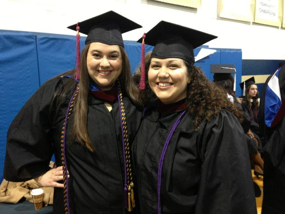 Photo - Amy Lecza and her friend Meagan Ewton take a picture together at Oral Roberts University's graduation in May. Lecza has since moved from Tulsa to Chicago to look for a permanent job.  PHOTO PROVIDED