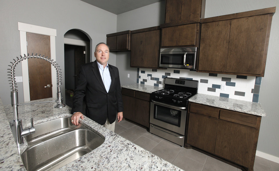 Photo -  Homebuilder Jay Evans shows the kitchen at the House of Hope, a fundraiser for the Cavett Kids Foundation.    PAUL B. SOUTHERLAND -  PAUL B. SOUTHERLAND