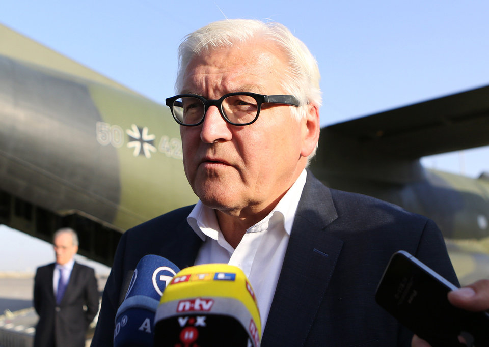Photo - German's Foreign Minister Frank-Walter Steinmeier, speaks to the press upon his arrival at the airport in Baghdad, Iraq, Saturday, Aug 16, 2014. (AP Photo/Hadi Mizban, Pool)