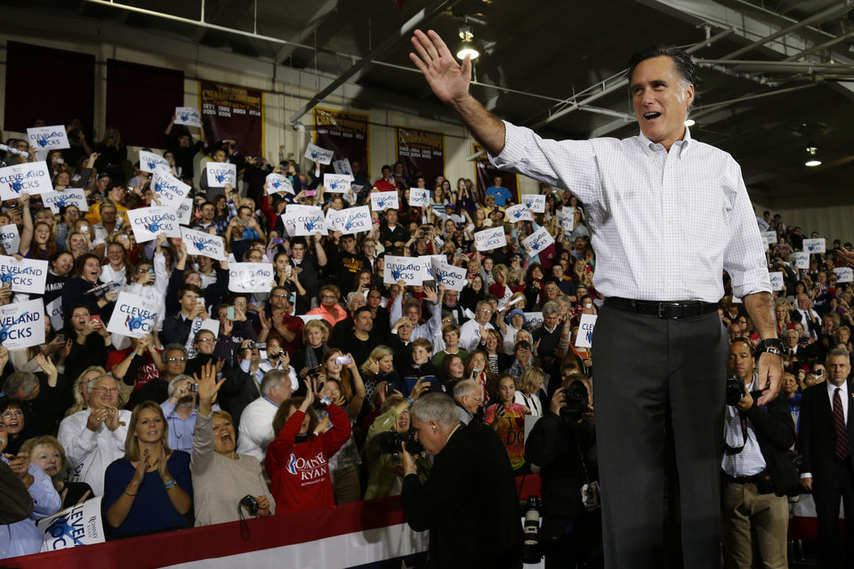 Photo -   Republican presidential candidate, former Massachusetts Gov. Mitt Romney waves to supporters as he takes the stage at a campaign stop at Avon Lake High School in Avon Lake, Ohio, Monday, Oct. 29, 2012. (AP Photo/Charles Dharapak)