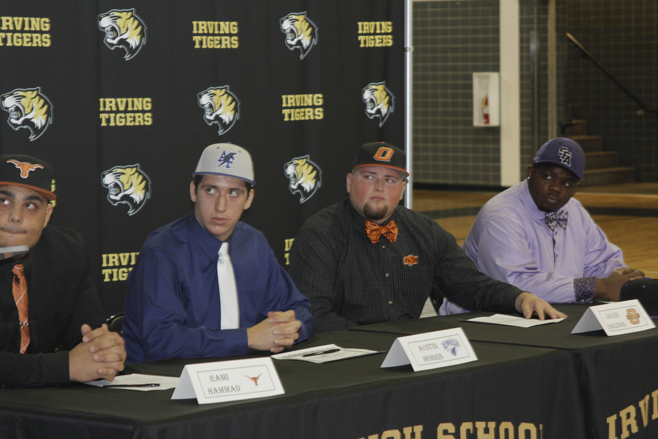 Photo - Oklahoma State signee Jaxon Salinas, second from right, after signing his national letter of intent at Irving High School in Irving, Texas. PHOTO BY GINA MIZELL, The Oklahoman