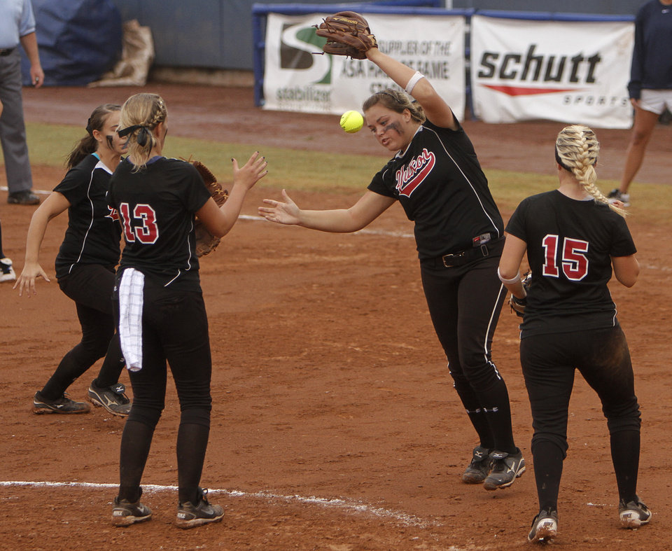 Yukon's Brianna Matthews (11) drops a catch during a 6A state softball semifinals game between Edmond North and Yukon at ASA Hall of Fame Stadium in Oklahoma City, Okla., Friday, Oct. 12, 2012.  Photo by Garett Fisbeck, The Oklahoman