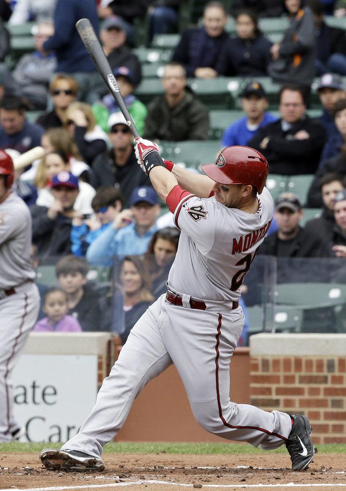 Photo - Arizona Diamondbacks' Miguel Montero hits an RBI double against the Chicago Cubs during the first inning of a baseball game in Chicago, Thursday, April 24, 2014. (AP Photo/Nam Y. Huh)