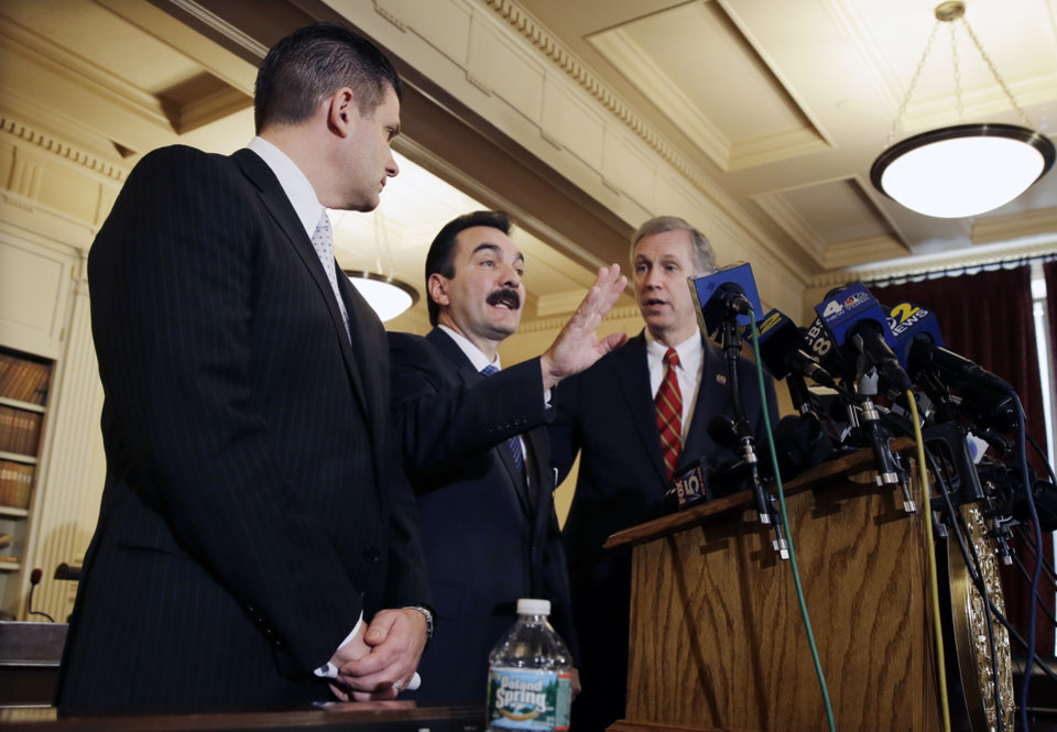 Photo - New Jersey Assemblymen John S. Wisniewski, right, D-Sayreville, N.J., and Loius D. Greenwald, left, D-Vorhees, N.J., listen as incoming Assembly Speaker Vincent Prieto, D-Secaucus, N.J., address the media. Monday, Jan. 13, 2014, in Trenton, N.J. The group announced a new special legislative committee will be tasked with finding out how high up New Jersey Gov. Chris Christie's chain of command a plot went that was linked through emails and text messages to a seemingly deliberate plan to create traffic gridlock in a town at the base of the George Washington Bridge after its mayor refused to endorse Christie for re-election. (AP Photo/Mel Evans)