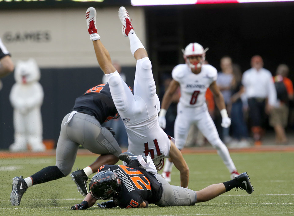 Photo - South Alabama's Evan Orth (14) is upended by Oklahoma State's Devin Harper (16) during a college football game between Oklahoma State (OSU) and South Alabama at Boone Pickens Stadium in Stillwater, Okla., Saturday, Sept. 8, 2018. Photo by Sarah Phipps, The Oklahoman