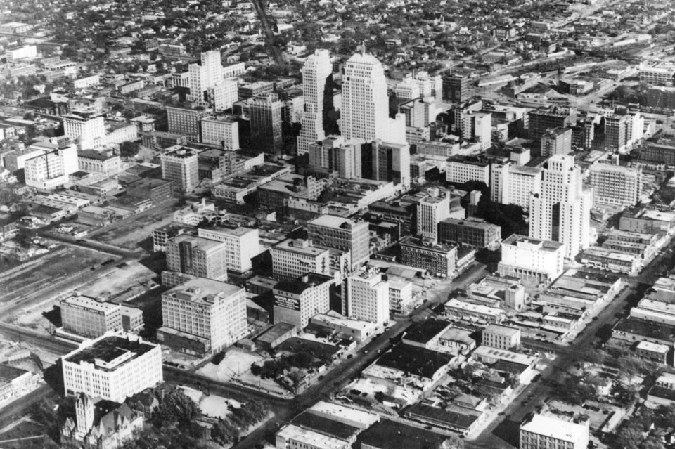 OKLAHOMA CITY / SKY LINE / OKLAHOMA / AERIAL VIEWS / AERIAL PHOTOGRAPHY / AIR VIEWS:  Biltmore hotel, in right fore-ground (tall pyramid building)  Two tallest buildings, standing together, right, First National Bank and left, Ramsey Tower.  Photo undated and unpublished.  Photo arrived in library on 10/06/1932.