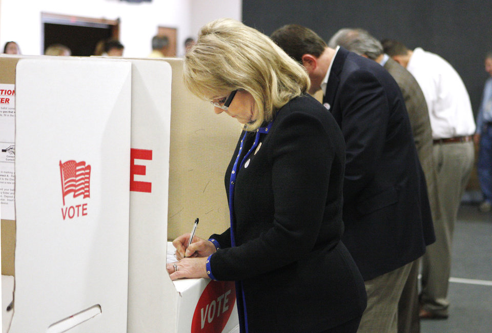 Photo - Gov. Mary Fallin in a voting booth marking her ballot at precinct 137 in Oklahoma City Tuesday, Nov. 6, 2012.  Photo by Paul B. Southerland, The Oklahoman