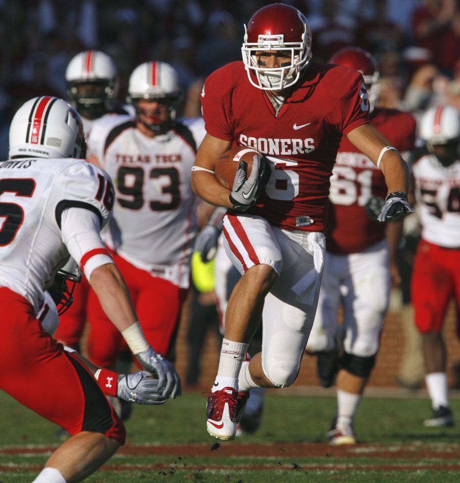 Photo - Receiver Cameron Kenney (6) runs after a catch in  first half of the college football game between the University of Oklahoma Sooners (OU) and the Texas Tech Red Raiders (TTU) at the Gaylord Family Memorial Stadium on Saturday, Nov. 13, 2010, in Norman, Okla.  Photo by Steve Sisney, The Oklahoman
