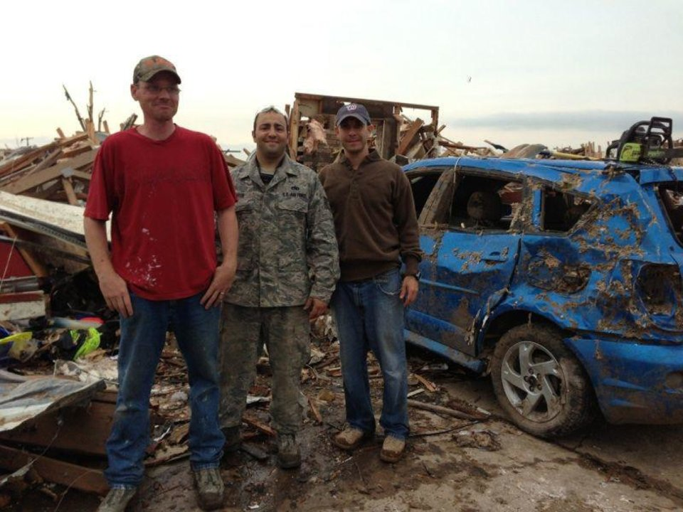 U.S. Air Force Tech. Sgt. Daniel Dashiell, left, Tech. Sgt. Nick Boyer and Tech. Sgt. Robert Lewis stand in front of the remains of the Dashiell home in Moore. <strong> - PROVIDED</strong>