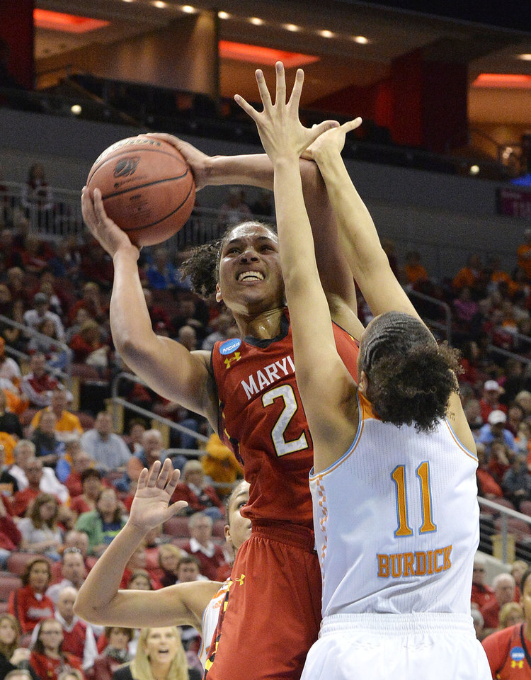 Photo - Maryland's Alyssa Thomas, left, shoots over the defense of Tennessee's Cierra Burdick during the second half in a regional semifinal game at the NCAA women's college basketball tournament on Sunday, March 30, 2014, in Louisville, Ky. Maryland defeated Tennessee 73-62. (AP Photo/Timothy D. Easley)