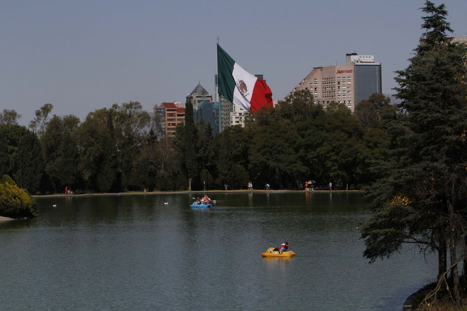 Photo -   Paddle boaters make their way around a lake in the Chapultepec Park in Mexico City, Monday, Nov. 19, 2012. Chapultepec is a park divided between shady stretches of forest and more-developed plazas, fountains and sculpture gardens. On weekends, the northern end is crammed with vendors, entertainers and families out for the day. (AP Photo/Marco Ugarte)