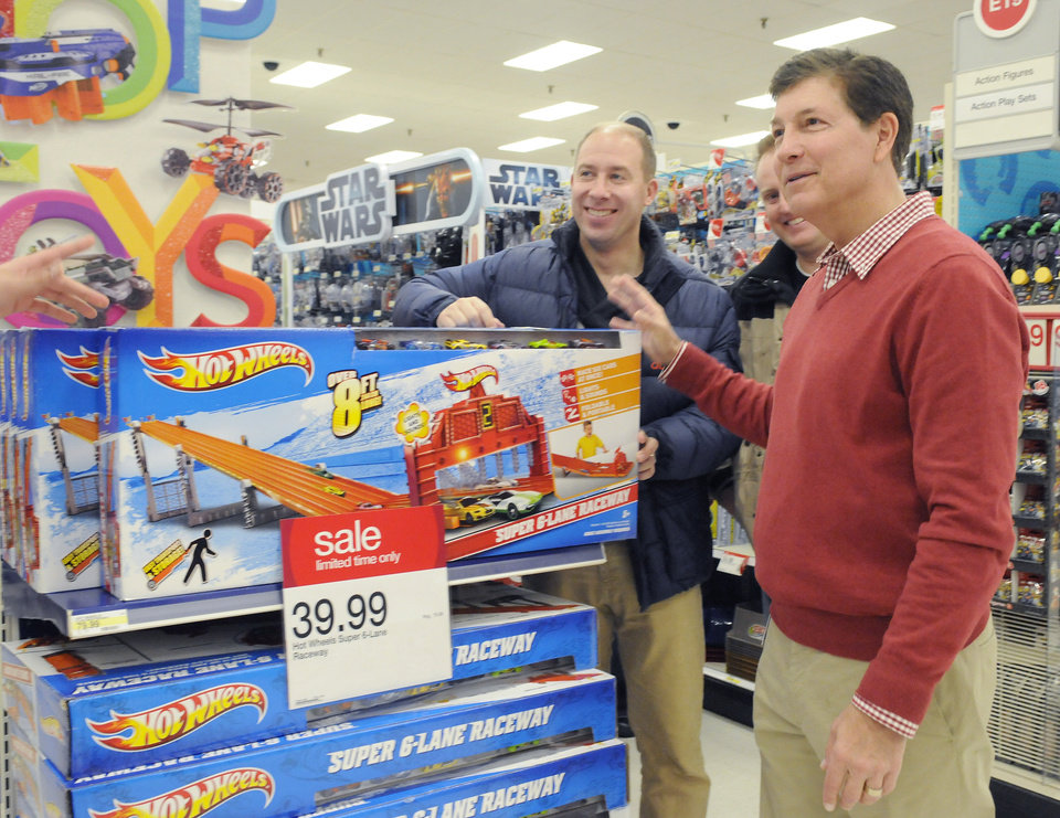 IMAGE DISTRIBUTED FOR TARGET - Gregg Steinhafel, Target CEO, checks out Black Friday sale items after Target opens its doors on Thursday, Nov. 22, 2012 in Bloomington, Minn. (Janet Hostetter/AP images for Target)