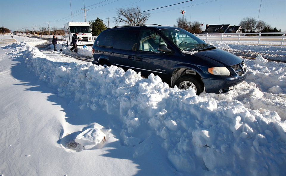 Photo - Cars stuck in deep snow drifts on Britton Road. Many spent Christmas Day, Dec. 25, 2009,  digging out from record snow storm that dumped 14 inches of snow in the Oklahoma City area.   Photo by Jim Beckel, The Oklahoman