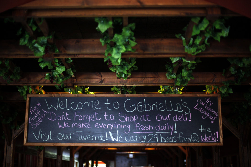 Photo - A sign welcomes guests at Gabriella's Italian Grill and Pizzeria in the old  County Line building on 1226 NE 63 in Oklahoma City, Friday, July 13, 2012. Photo by Sarah Phipps, The Oklahoman.  SARAH PHIPPS - SARAH PHIPPS