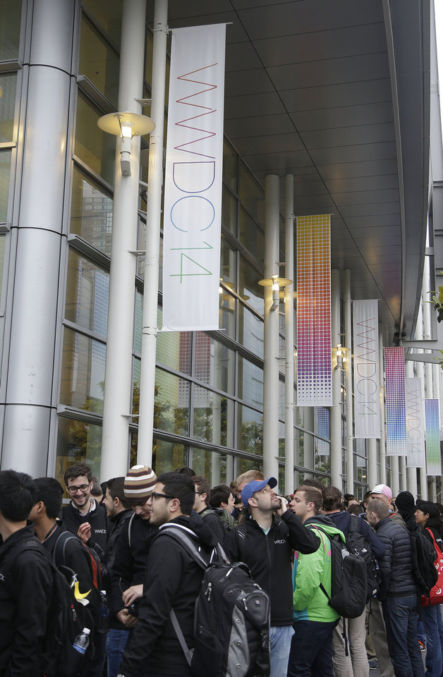 Photo - A crowd lines up before the Apple World Wide Developers Conference 2014 at the Moscone Center in San Francisco, Monday, June 2, 2014. This week should provide a better sense of whether Apple is heading down promising new avenues of growth or whether it's still wandering aimlessly around well-trod territory in search of another breakthrough. (AP Photo/Jeff Chiu)