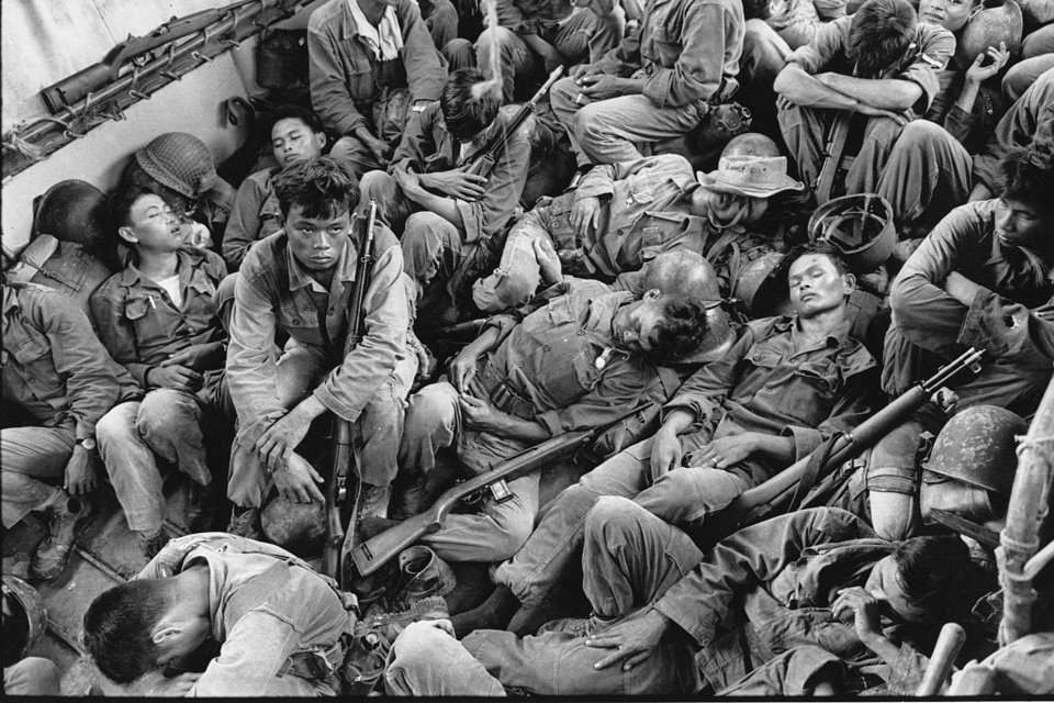 Photo -   FILE - In this Aug. 1962 file photo shot by Associated Press photographer Horst Faas, South Vietnamese government troops from the 2nd Battalion of the 36th Infantry sleep in a U.S. Navy troop carrier on their way back to the Provincial capital of Ca Mau, Vietnam. Faas, a prize-winning combat photographer who carved out new standards for covering war with a camera and became one of the world's legendary photojournalists in nearly half a century with The Associated Press, Thursday May 10, 2012. He was 79. (AP Photo/Horst Faas, File)