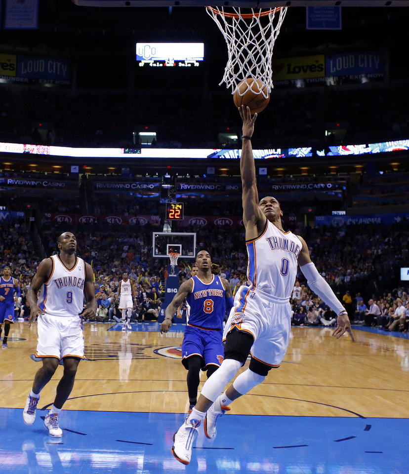 Photo - Oklahoma City's Russell Westbrook (0) shoots a lay up in front of New YorK's J.R. Smith (8) during NBA basketball game between the Oklahoma City Thunder and the New York Knicks at the Chesapeake Energy Arena, Sunday, April 7, 2010, in Oklahoma City Photo by Sarah Phipps, The Oklahoman